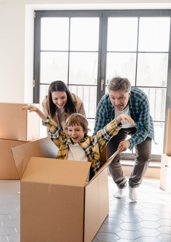 Family playing with moving box